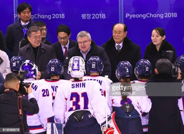 TOPSHOT South Korean president Moon Jaein IOC President Thomas Bach North Korea's ceremonial head of state Kim Yong Nam and North Korean leader Kim...