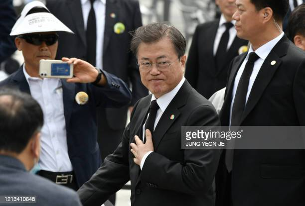 South Korean President Moon Jaein leaves after a ceremony marking the 40th anniversary of the prodemocracy Gwangju Uprising at May 18 Democracy...