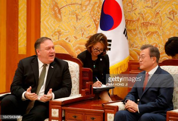 South Korean President Moon Jaein listens to US Secretary of State Mike Pompeo during a meeting at the presidential Blue House in Seoul on October 7...