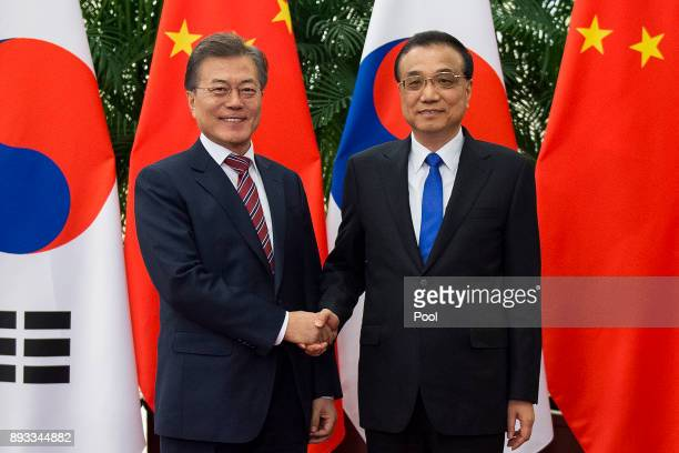 South Korean President Moon JaeIn shake hands with China's Premier Li Keqiang at the Great Hall of the People on December 15 2017 in Beijing China