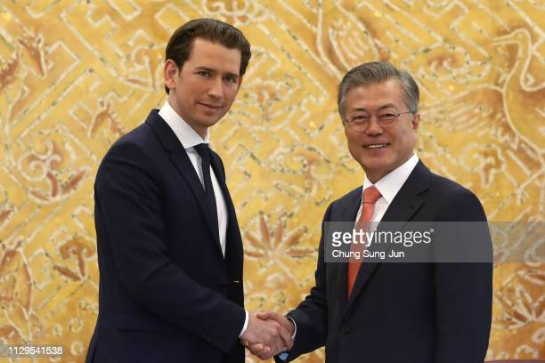 South Korean President Moon JaeIn shakes hands with Austria's Chancellor Sebastian Kurz during a meeting at the Presidential Blue House on February...
