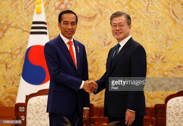 South Korean President Moon Jae-In shakes hands with Indonesian President Joko Widodo before their meeting at the Presidential blue house on...