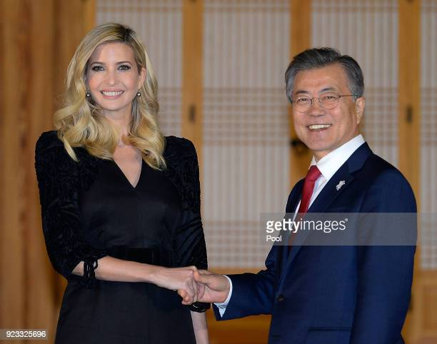 South Korean President Moon Jae-In shakes hands with Ivanka Trump during their dinner at the Presidential Blue House on February 23, 2018 in Seoul,...