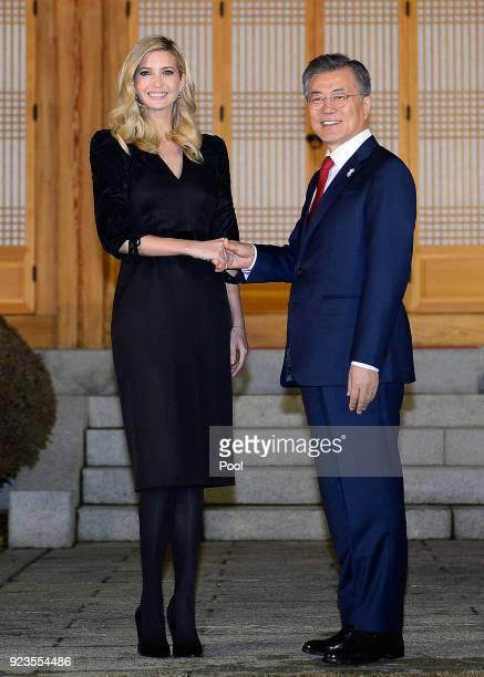 South Korean President Moon JaeIn shakes hands with Ivanka Trump during their dinner at the Presidential Blue House on February 23 2018 in Seoul...