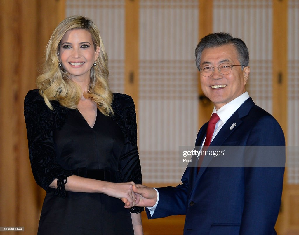 South Korean President Moon Jae-In (R) shakes hands with Ivanka Trump (L) during their dinner at the Presidential Blue House on February 23, 2018 in Seoul, South Korea. Ivanka Trump is on a four-day visit to South Korea to attend the closing ceremony of the Pyeongchang Winter Olympics and to meet South Korean President Moon.