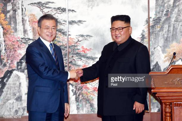 South Korean President Moon Jae-in shakes hands with North Korean leader Kim Jong Un during a joint press conference at Paekhwawon State Guesthouse...