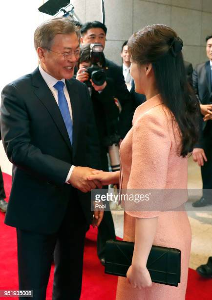 South Korean President Moon Jaein shakes hands with North Korean first lady Ri Solju upon arrival at the Peace House on April 27 2018 in Panmunjom...