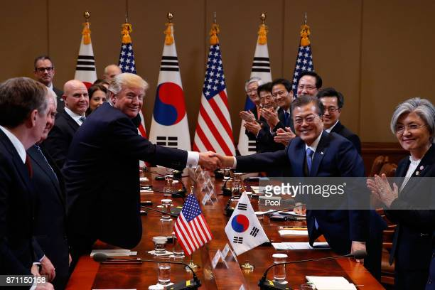South Korean President Moon JaeIn shakes hands with US President Donald Trump during their summit at the presidential Blue House on November 7 2017...