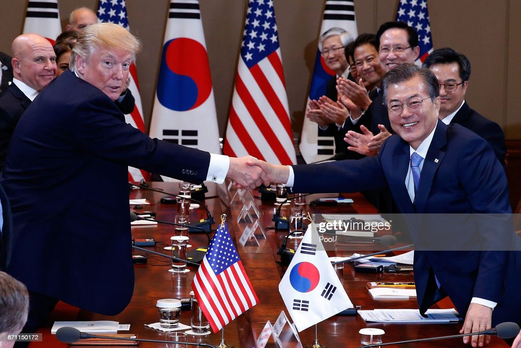 South Korean President Moon Jae-In (R) shakes hands with U.S. President Donald Trump (L) during their summit at the presidential Blue House on November 7, 2017 in Seoul, South Korea. Trump is in South Korea as a part of his Asian tour.