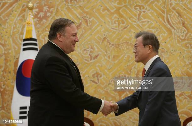 South Korean President Moon Jaein shakes hands with US Secretary of State Mike Pompeo during a meeting at the presidential Blue House in Seoul on...