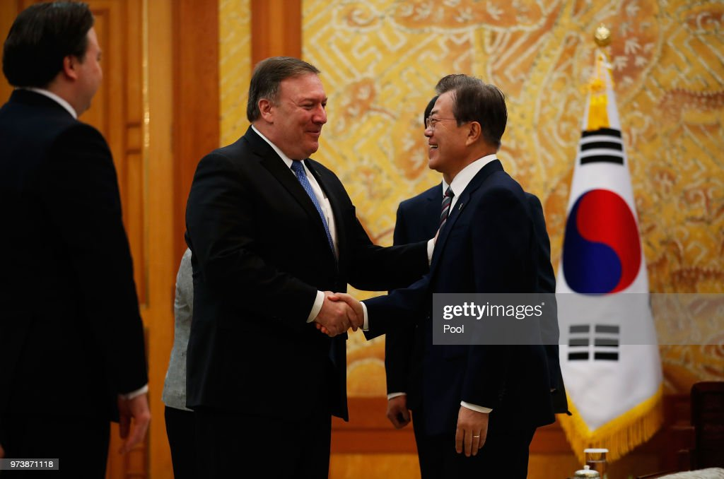 South Korean President Moon Jae-in shakes hands with U.S. Secretary of State Mike Pompeo during their meeting at the presidential blue house June 14, 2018 in Seoul, South Korea. U.S. Secretary of State Mike Pompeo visited South Korea to meet South Korea's President Moon Jae-in and Japan's Foreign Minister following a landmark meeting between U.S. President Donald Trump and North Korean leader Kim Jong-un.