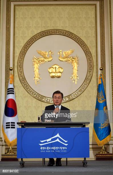 South Korean President Moon Jaein speaks during a press conference marking his first 100 days in office at the presidential blue house on August 17...