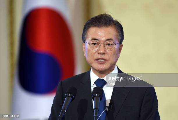 South Korean President Moon Jae-in speaks during a press conference marking his first 100 days in office at the presidential blue house on August 17,...