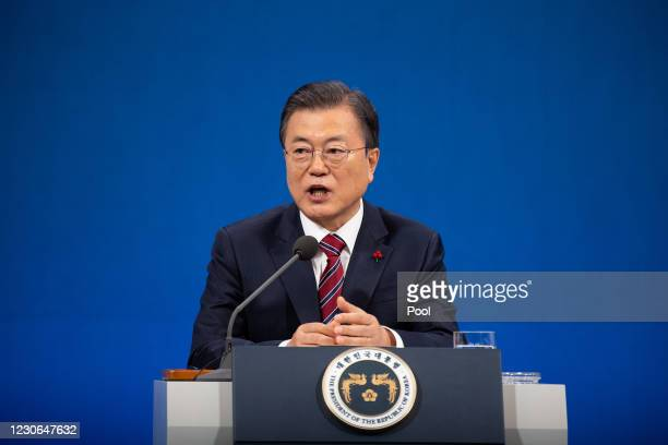 South Korean President Moon Jae-in speaks during an on-line New Year press conference with local and foreign journalists at the Presidential Blue...
