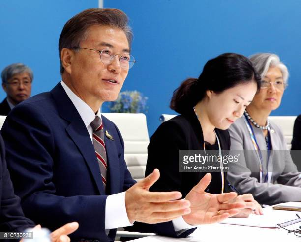 South Korean President Moon Jaein talks to Japanese Prime Minister Shinzo Abe during their bilateral meeting on the sidelines of the G20 Summit on...