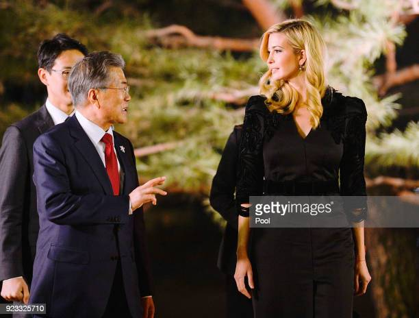 South Korean President Moon JaeIn talks with Ivanka Trump during their dinner at the Presidential Blue House on February 23 2018 in Seoul South Korea...