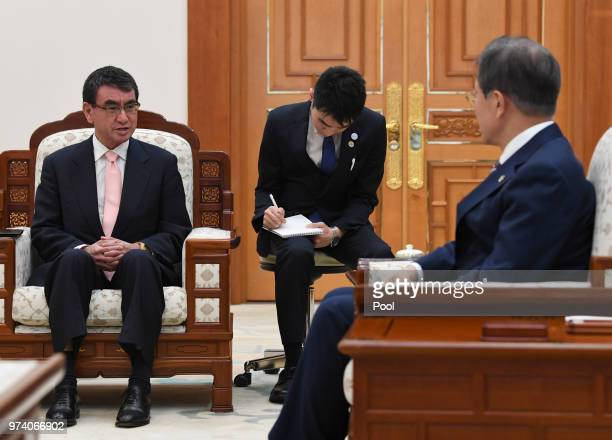 South Korean President Moon Jaein talks with Japanese Foreign Minister Taro Kono during their meeting at presidential blue houes on June 14 2018 in...