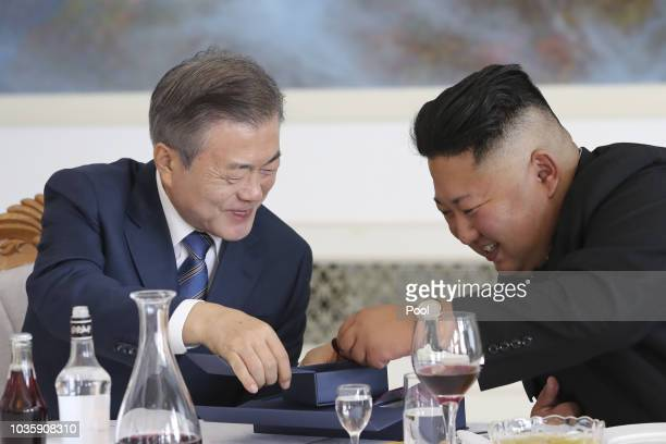 South Korean President Moon Jae-in talks with North Korean leader Kim Jong Un during a lunch at the Okryugwan restaurant on September 19, 2018 in...