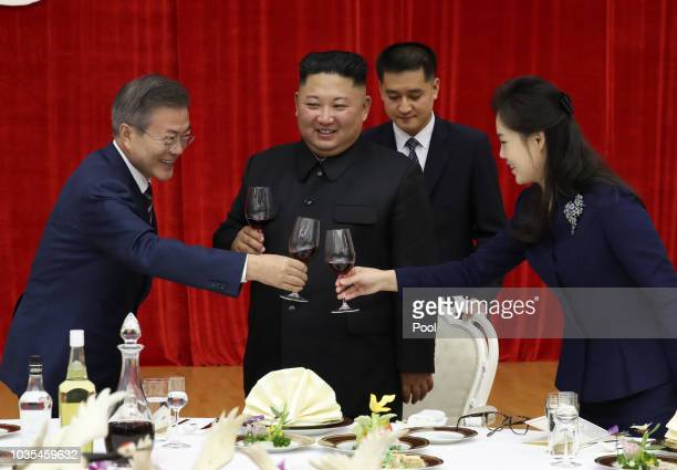 South Korean President Moon Jaein toasts with North Korea's leader Kim Jong Un and his wife Ri Sol Ju during a welcoming dinner on September 18 2018...