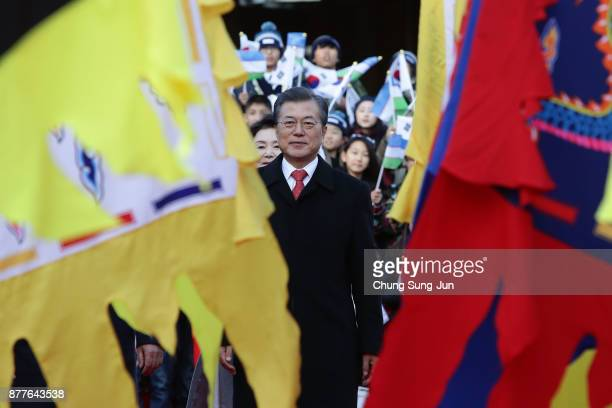 South Korean President Moon JaeIn walks walk during a welcoming ceremony with Uzbekistan President Shavkat Mirziyoyev at the presidential Blue House...