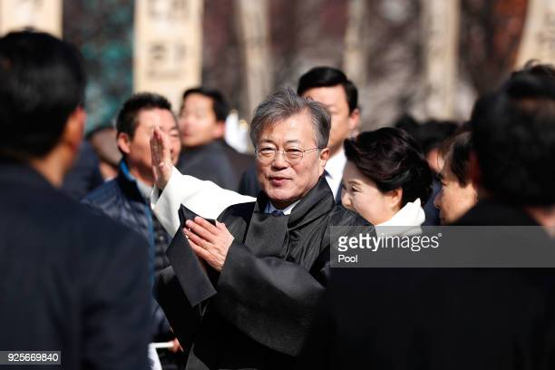 South Korean President Moon Jae-In waves during a march to commemorate the 99th Independence Movement Day ceremony at Seodaemun Prison History Hall...