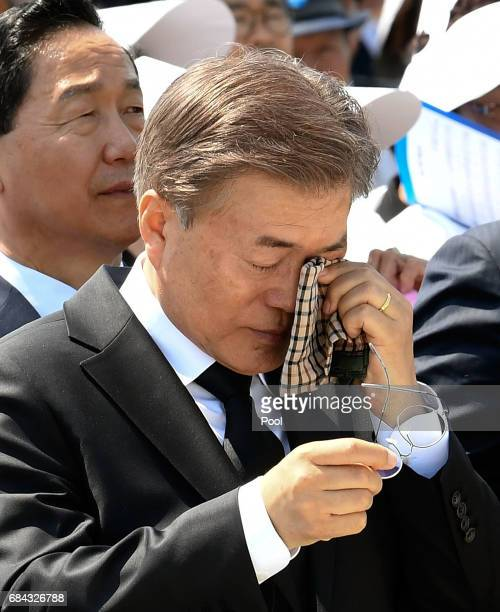 South Korean President Moon Jaein wipes tears during the 37th annual May 18 Democratic Uprising memorial at the Gwangju National Cemetery on May 18...