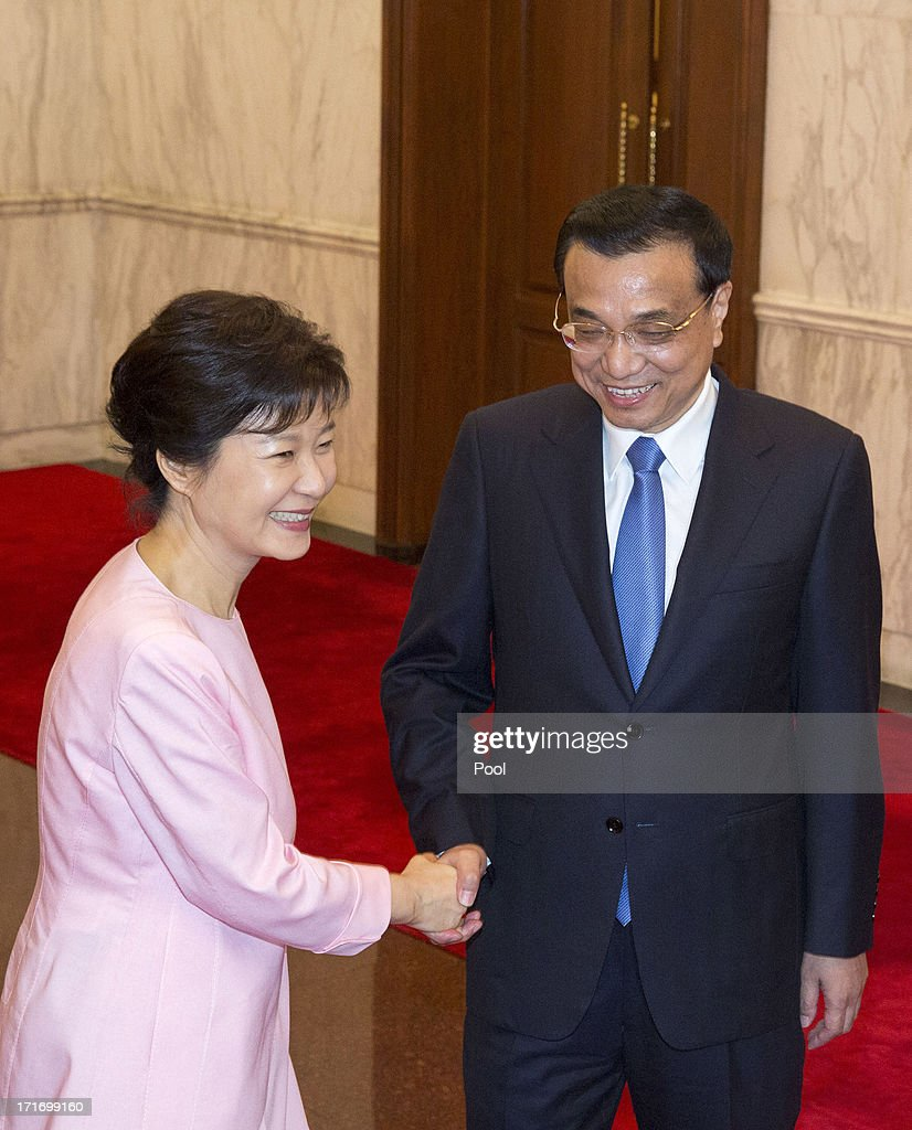 South Korean President Park Geun-Hye (L) and Chinese Premier Li Keqiang (R) meet at the Diaoyutai State Guesthouse on June 28, 2013 in Beijing, China. South Korean President Park Geun-Hye is on a four-day visit to China.