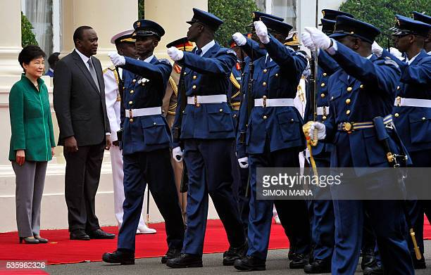 South Korean President Park Geunhye and her Kenyan counterpart Uhuru Kenyatta looks at the Kenya Airforce marching May 31 2016 at the StateHouse in...