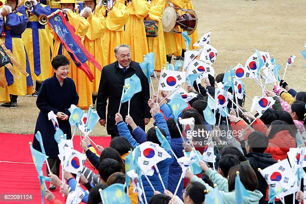South Korean President Park Geun-Hye and Kazakhstan President Nursultan Nazarbayev are greeted by South Korean elementary school students during a...
