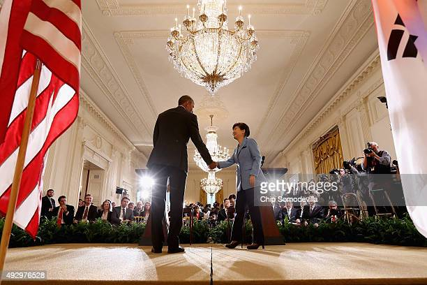 South Korean President Park Geun-hye and U.S. President Barack Obama shake hands at the conclusion of a joint press conference in the East Room of...