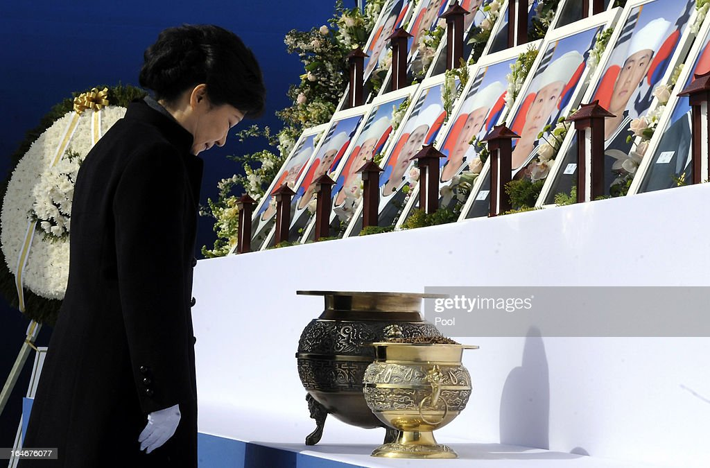 South Korean President Park Geun-Hye bows during a memorial ceremony to commemorate the victims of Cheonan warship sinking at the National Ceremtery on March 26, 2013 in Daejeon, South Korea. The warship exploded and sank, later found the fact that North Korea torpedoed, though Pyongyang denied, killed 46 sailors.
