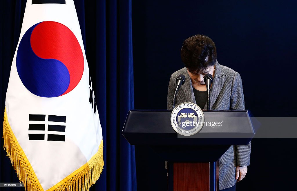 South Korean President Park Geun-Hye bows during an address to the nation, at the presidential Blue House in Seoul on November 29, 2016. South Korea's scandal-hit President Park Geun-Hye said Tuesday she was willing to stand down early and would let parliament decide on her fate.