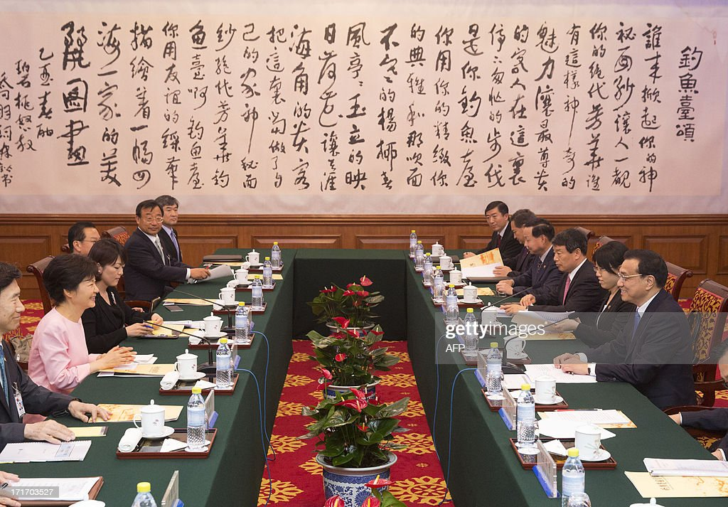 South Korean President Park Geun-Hye (centre L) holds talks with Chinese Chairman of the National People's Congress Zhang Dejiang (centre R) at the Great Hall of the People in Beijing on June 28, 2013. Park Geun-Hye is on a visit to China from June 27 to 30.