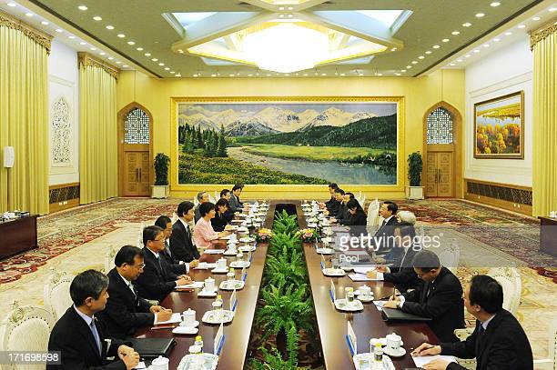 South Korean President Park GeunHye meets with Chinese Chairman of the National People's Congress Zhang Dejiang at the Great Hall of the People on...
