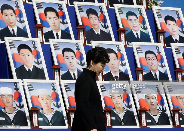 South Korean President Park GeunHye passes by portraits of the 46 deceased sailors from the South Korean naval ship Cheonan during a ceremony to mark...