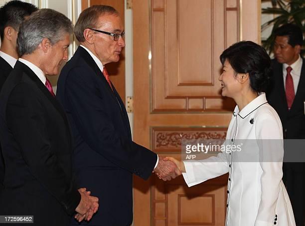 South Korean President Park Geunhye shakes hands with Australian Foreign Minister Bob Carr as Australian Defense Minister Stephen Smith looks on...