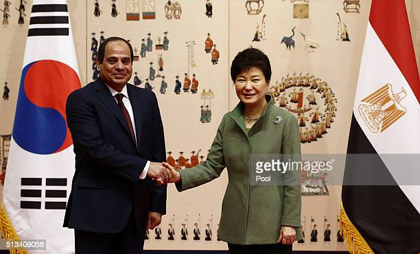 South Korean President Park GeunHye shakes hands with Egyptian President AbdelFattah elSisi during their meeting at the presidential Blue House on...
