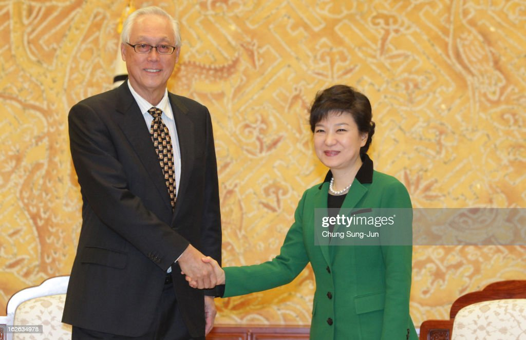 South Korean President Park Geun-Hye (R) shakes hands with Goh Chok Tong, Senior Minister and former Prime Minister of Singapore after inauguration ceremony at presidential house on February 25, 2013 in Seoul, South Korea. Park, the daughter of former Republic of Korea Army general and dictator from 1961 to 1979 Park Chung-hee, was today sworn in as the first female president of South Korea.
