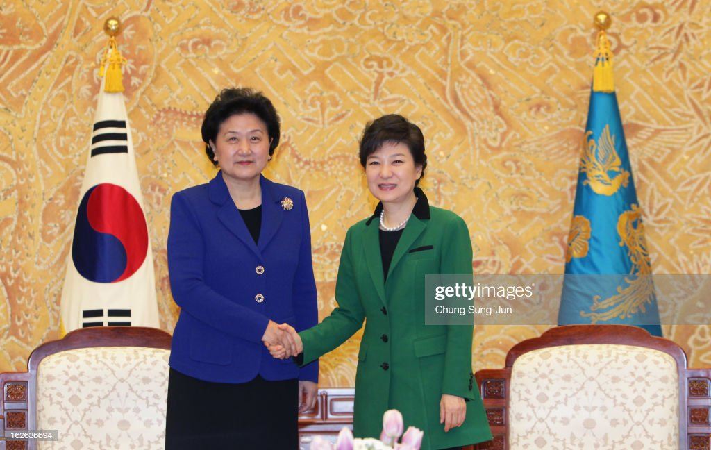 South Korean President Park Geun-Hye (R) shakes hands with Liu Yandong, official of the Communist Party of China, after her inauguration ceremony at presidential house on February 25, 2013 in Seoul, South Korea. Park, the daughter of former Republic of Korea Army general and dictator from 1961 to 1979 Park Chung-hee, was today sworn in as the first female president of South Korea.