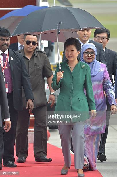 South Korean President Park GeunHye walks with Malaysian Minister of Woman Family and Community Development Rohani Abdul Karim following her arrival...