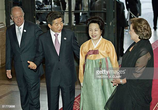 South Korean President Roh Moo-Hyun and his wife are greeted by Chilean President Ricardo Lagos and his wife Luisa Duran upon their arrival at the...