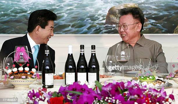 South Korean President Roh MooHyun and North Korean Leader Kim JongIl talk after signing the peace declaration during the two Korea Summit on October...