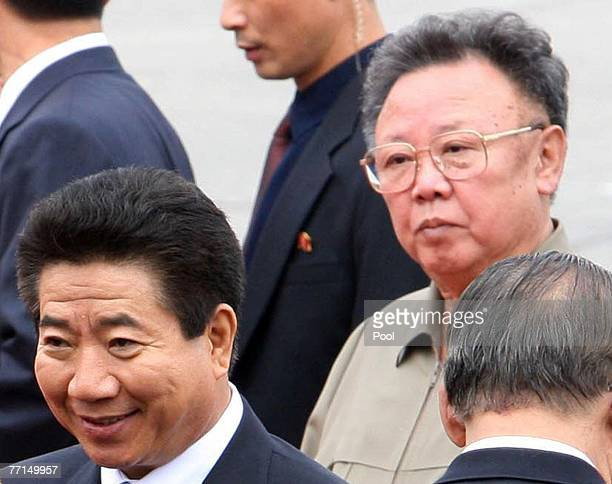 South Korean President Roh MooHyun greets North Korean officals as North Korean leader Kim JongIl looks on during welcoming ceremony on October 2...
