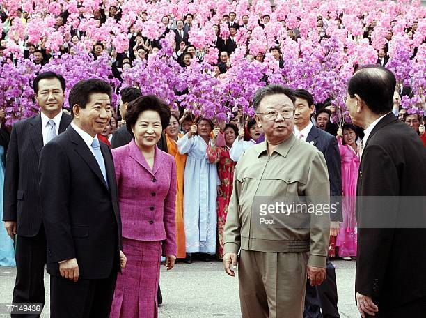 South Korean President Roh MooHyun his wife Kwon YangSook and North Korean leader Kim JongIl listen to the North Korean deputy leader Kim YongNam at...