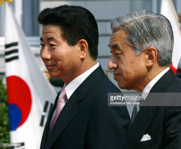 South Korean President Roh Moo-Hyun is joined by Japanese Emperor Akihito during a welcoming ceremony at the Akasaka Palace State Guesthouse in...