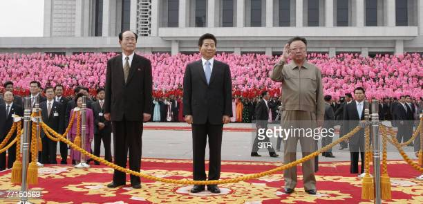 South Korean President Roh Moo-Hyun , North Korean leader Kim Jong-Il and North Korean figurehead head of state Kim Yong-Nam watch a military parade...