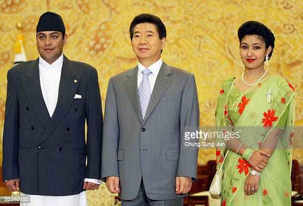 South Korean President Roh MooHyun poses with Nepalese Crown Prince Paras Bir Bikram Shah Dev and Crown Princess Himani Rajya Laxmi Devi Shah at the...