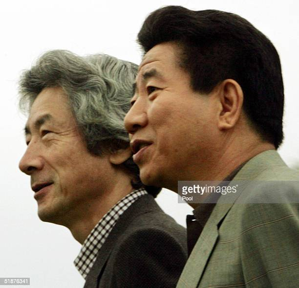 South Korean President Roh Moo-hyun takes a stroll with Japanese Prime Minister Junichiro Koizumi at a hot springs resort on December 18, 2004 in...