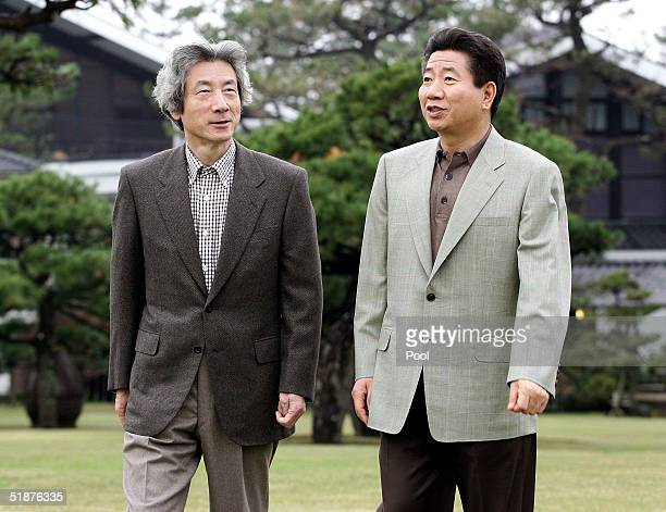 South Korean President Roh Moo-hyun walks in a garden of a hotel with Japanese Prime Minister Junichiro Koizumi at a hot springs resort on December...