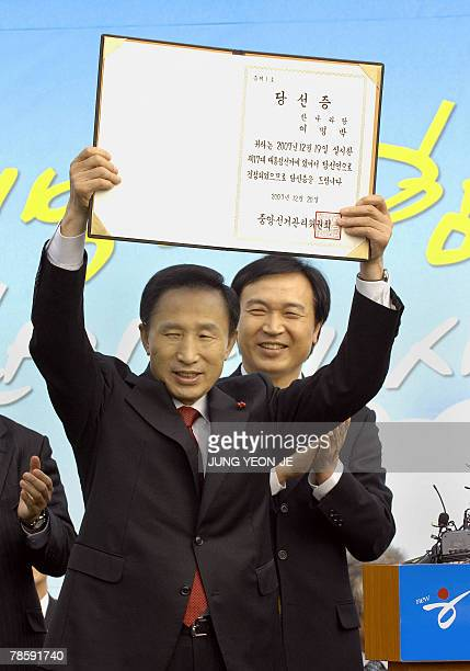 South Korean presidentelect Lee MyungBak holds up a certificate of presidentelect he received from the National Election Commission during a...